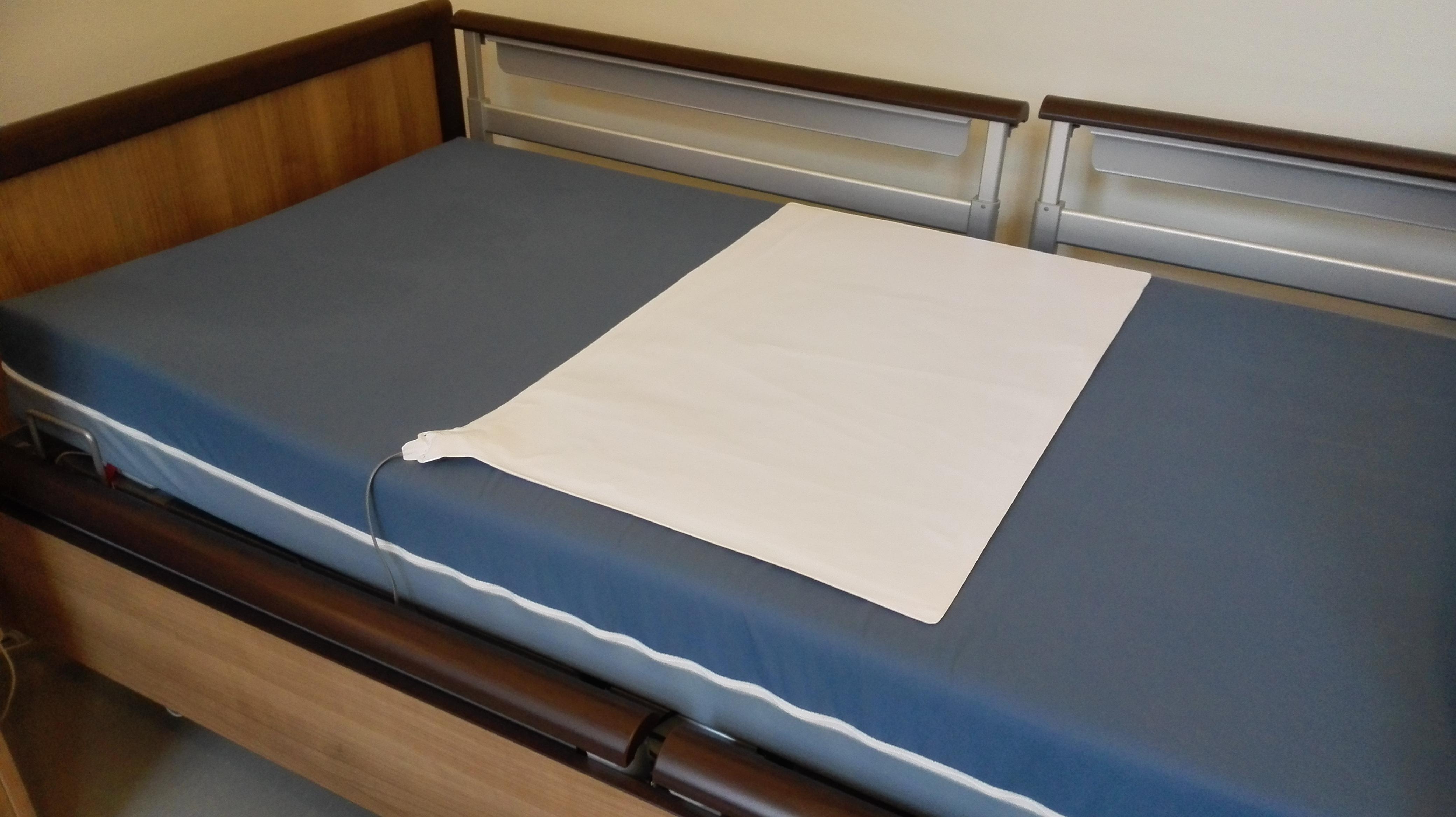 Trykkmatte i seng eller stol som varsler når du forlater den.